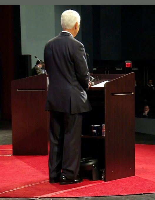 This video frame grab made available by CBS 4, shows a fan at the bottom of the lectern near Democratic gubernatorial candidate Charlie Crist in Davie, Fla., Wednesday Oct. 15, 2014. The fan caused a delay in the gubernatorial debate between Crist and Governor Rick Scott, after the Scott campaign considered the fan a violation of the rules prohibiting the use of electronic devices.