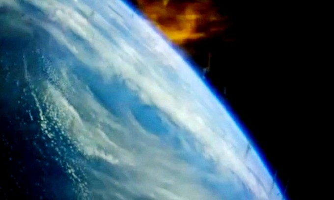 Dec. 5, 2014 –- A video camera onboard NASA's Orion spacecraft captured views out the window during the heat of re-entry is the capsule plumitted back toward Earth. Photo: NASA