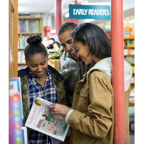 """""""President Obama with daughters Malia and Sasha shop for Christmas gifts at Politics and Prose, a bookstore in Washington, DC on #SmallBizSat"""" By Pete Souza via Instagram"""