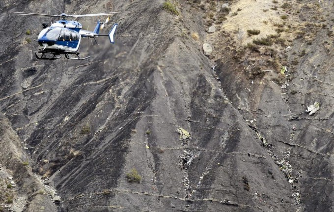 A French gendarme helicopter flies over the crash site of an Airbus A320, near Seyne-les-Alpes, March 25, 2015. REUTERS/Emmanuel Foudrot