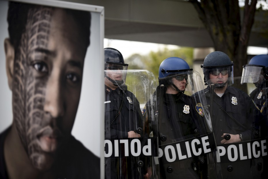 Police form a line during clashes with protesters near Mondawmin Mall after Gray's funeral.  [Reuters]