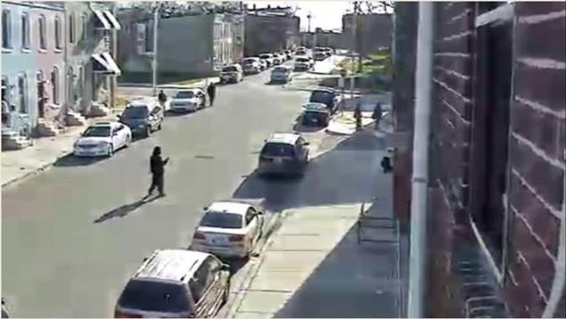 Baltimore investigators released this still image from surveillance video, showing Kevin Moore at the site of Gray's arrest. Baltimore authorities said Moore is wanted for questioning.