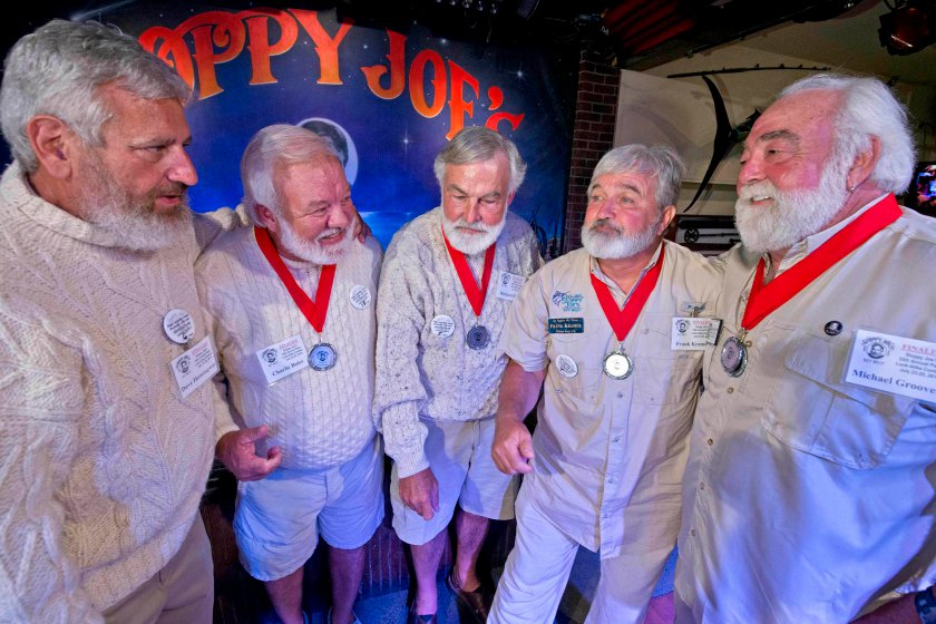 "Five finalists in the 2015 ""Papa"" Hemingway Look-Alike Contest congratulate each other on the stage at Sloppy Joe's Bar in this handout photo provided by the Florida Keys News Bureau in Key West, Florida, July 25, 2015.  Dave Hemingway (L to R), Charlie Boice, Richard Filip, Frank Kramer and Michael Groover pose for a photo. The competition is a facet of the island's annual Hemingway Days festival.  REUTERS/Andy Newman/Florida Keys News Bureau"