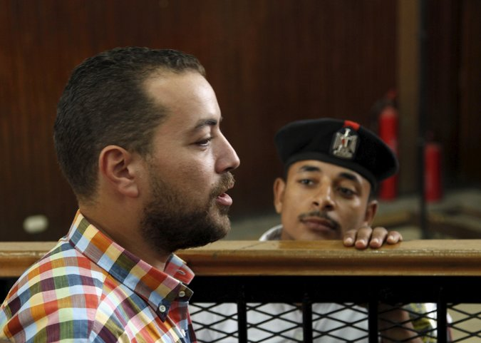 Baher Mohamed, a journalist with Al Jazeera English, in the court room on Saturday in Cairo. Credit Asmaa Waguih/Reuters