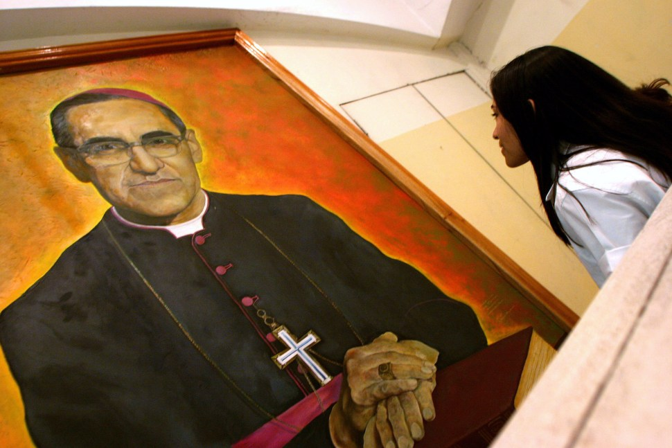 A Salvadorean views an image of the Catholic Bishop Arnulfo Romero on the anniversary of his  assassination in El Salvador. REUTERS
