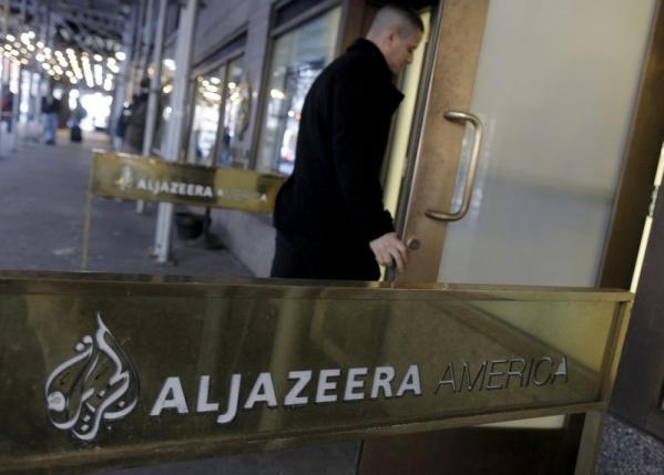 An employee enters the Al Jazeera America broadcast center NYC Jan 13, 2016.  REUTERS