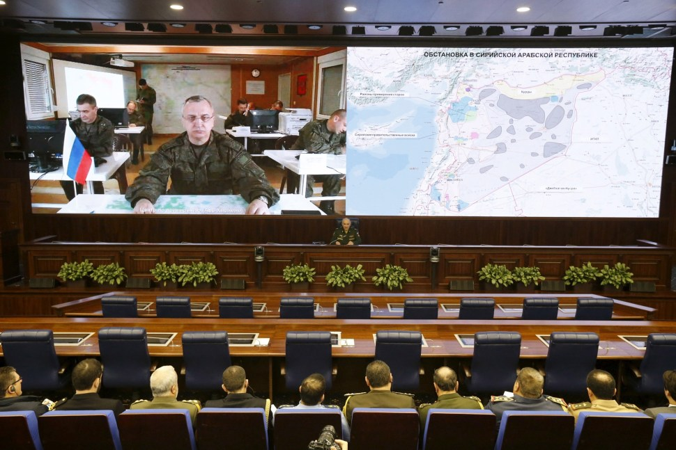 Russian military official Sergei Kuralenko is pictured on screen during a video link with foreign military attaches at a news briefing, organized by Russian Defense Ministry in Moscow, Russia, February 27, 2016.