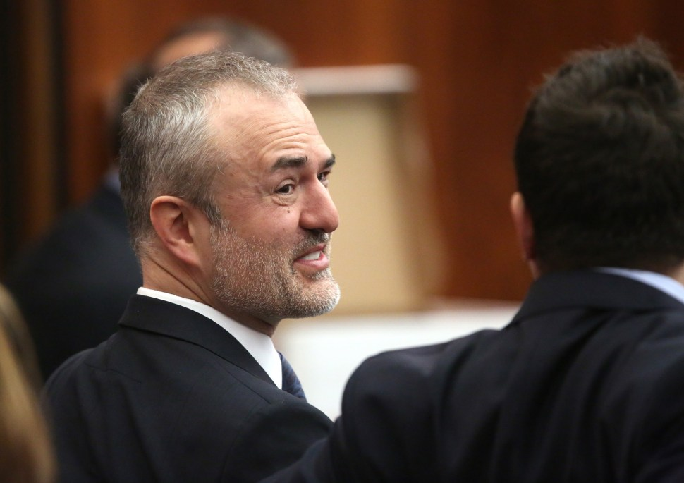 Gawker founder Nick Denton talks with his legal team before Hulk Hogan testifies in court, St Petersburg, Florida March 8, 2016.
