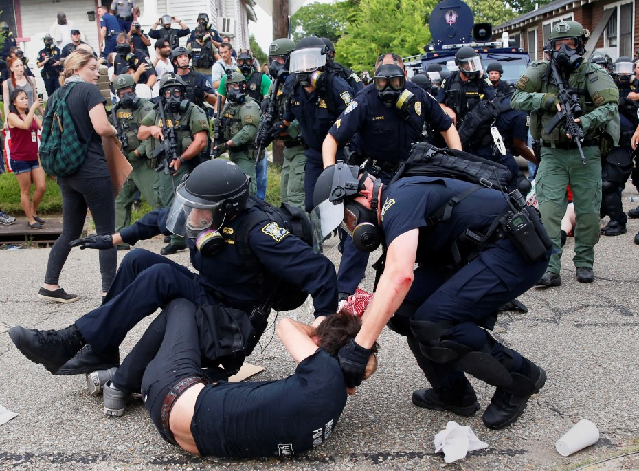 A demonstrator is detained by police during protests in Baton Rouge, Louisiana, U.S., July 10, 2016. REUTERS/Shannon Stapleton