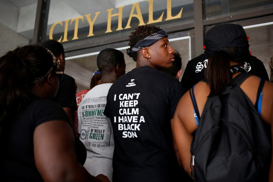Demonstrators stand in front of the East Baton Rouge Parish City Hall doors in Baton Rouge, Louisiana, U.S. July 11, 2016.  REUTERS/Shannon Stapleton