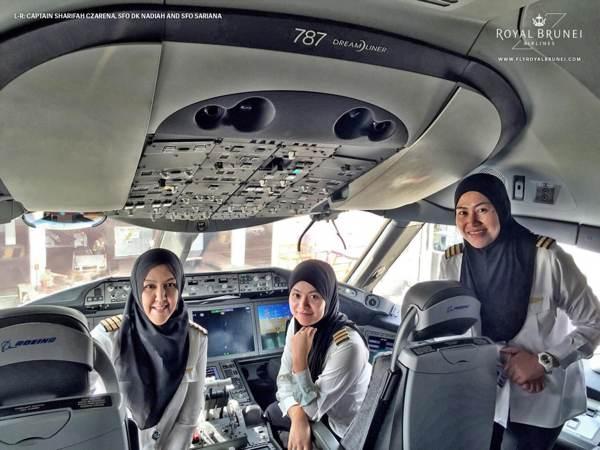 Captain Sharifah Czarena Surainy Syed Hashim, Senior First Officer Dk Nadiah Pg Khashiem and Senior First Officer Sariana Nordin in the cockpit of  a Boeing 787 Dreamliner