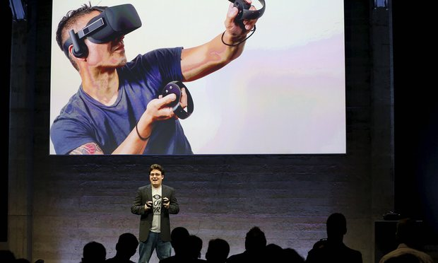 Oculus Founder Palmer Luckey displays an Oculus Touch input during an event in San Francisco. Reuters
