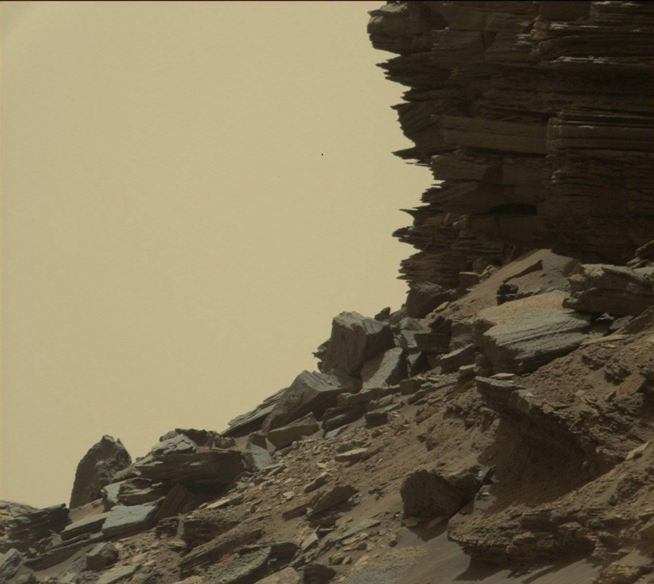 "This view from Curiosity shows a dramatic hillside outcrop with sandstone layers that scientists refer to as ""cross-bedding."" Image Credit: NASA/JPL-Caltech/MSSS"