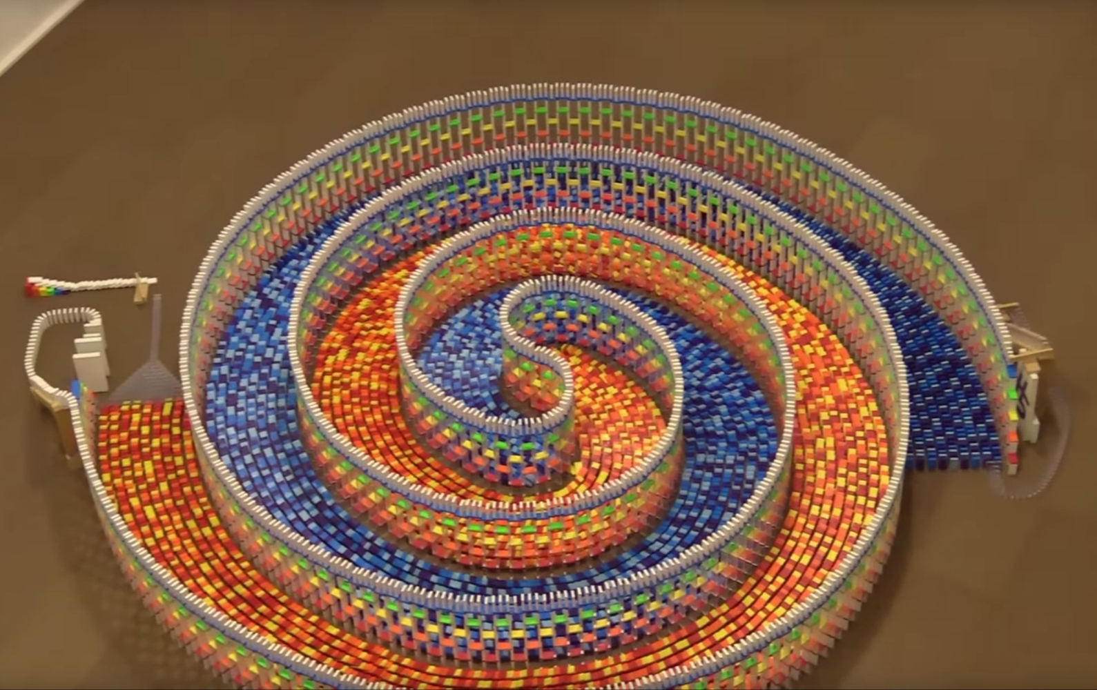 Gorgeous Triple Spiral Of 15K Dominoes Comes Tumbling Down