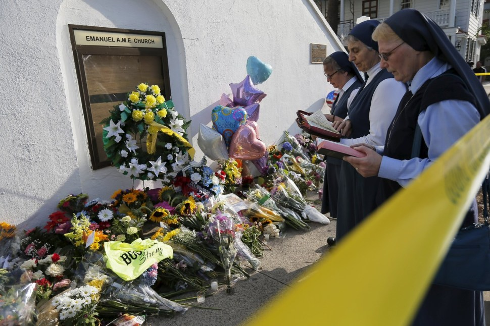 Nuns from the Daughters of St. Paul pray outside the Emanuel African Methodist Episcopal Church on Friday. BRIAN SNYDER/REUTERS
