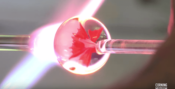 Watch this real-time creation of a glass flower encased in a sphere