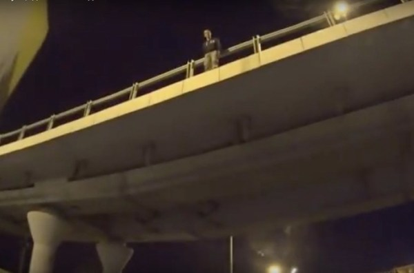 Watch: Heroic man on motorcycle saves the life of a man about to jump