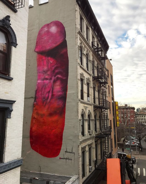 Street artist erects a giant pink penis in new york city for Mural on broome street
