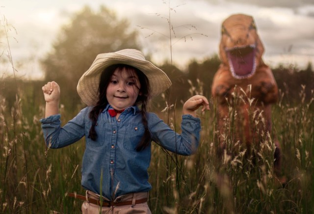 Austistic boy hates being in photos, mom lets him wear T-Rex suit for family pics