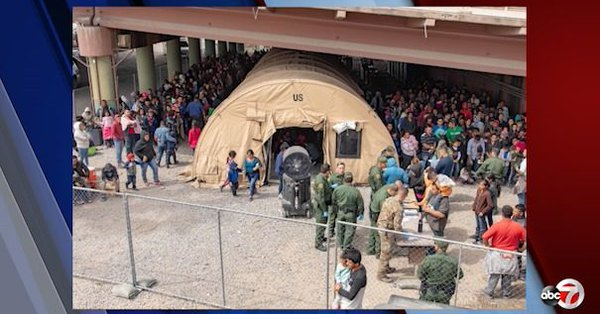 """Border Patrol holds asylum seekers in tent under a bridge, calls it a """"transitional camp"""""""