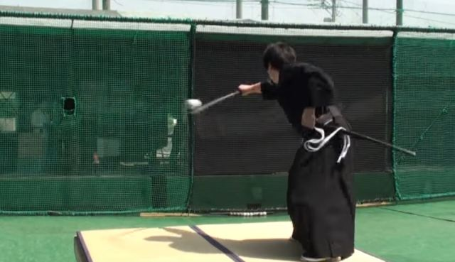 Swordsman slices 100mph baseball in two