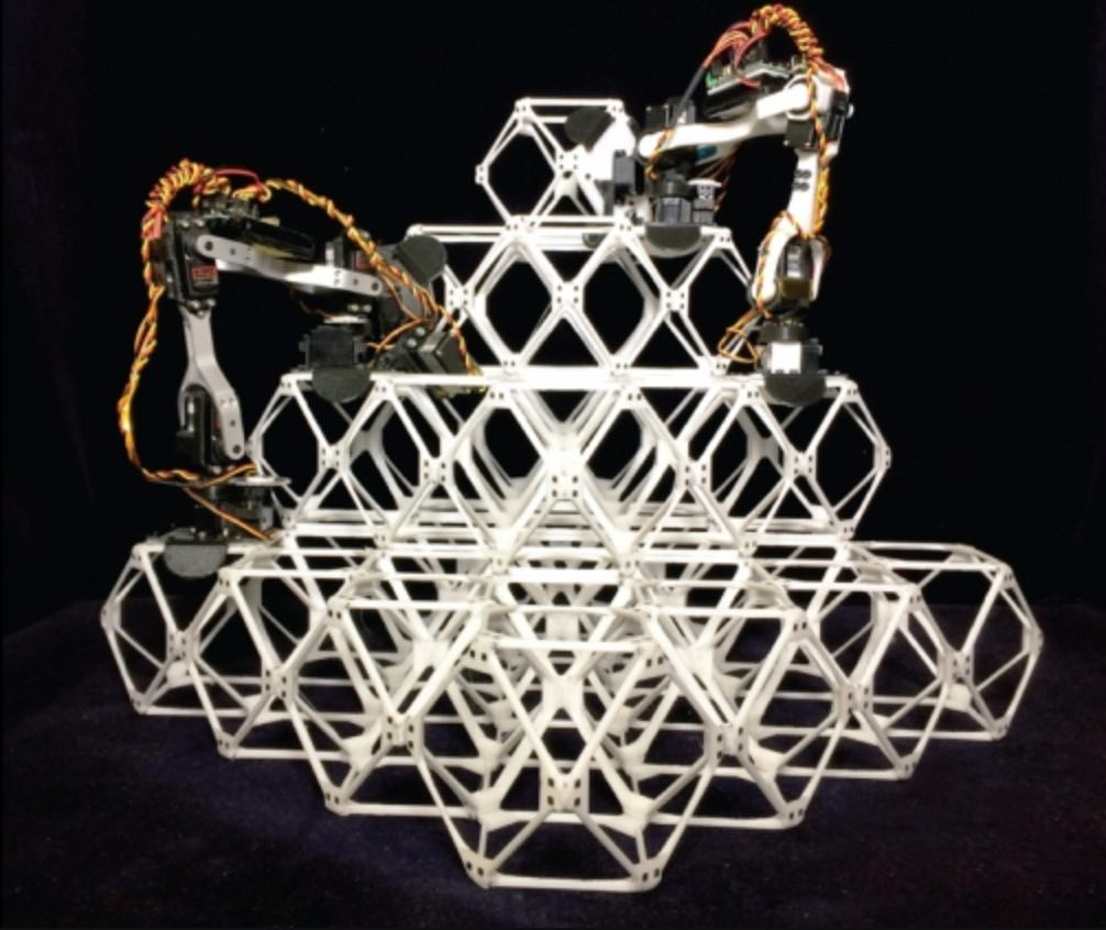 Robot assemblers build structures out of identical modular pieces