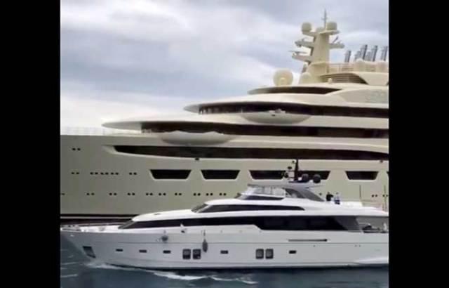 Large yacht passes by gargantuan yacht