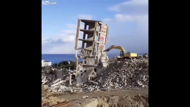 Building collapses, taking demolishing equipment down with it