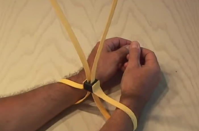 Magic trick revealed: how to escape from plastic handcuffs