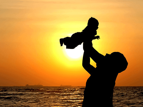 Mother-holding-baby-in-air
