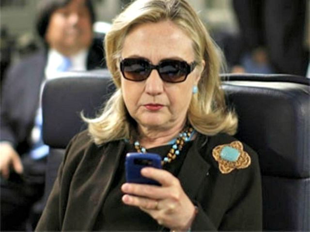 Hillary-on-her-Phone-AP-Photo-640x480.jp