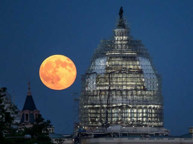 In this handout provided by the National Aeronautics and Space Administration (NASA), a second full moon for the month of July rises behind the dome of the U.S. Capitol on July 31, 2015 in Washington, DC. In recent years, people have been using the name Blue Moon for the second of two full moons in a single calendar month. An older definition of Blue Moon is that it is the third of four full moons in a single season. (Photo by