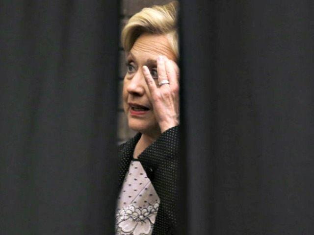 Hillary behind curtain Morry GashAP