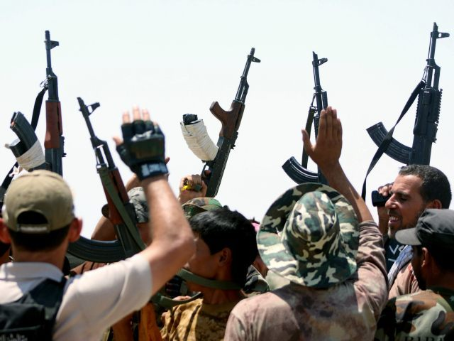 Image result for Iran-backed Iraqi Shi'ite militias, photos