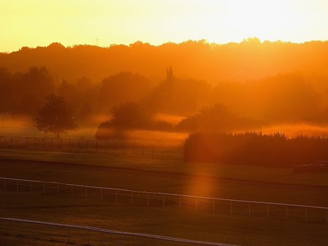 DONCASTER, ENGLAND - SEPTEMBER 26:  Mist shrouds the back straight of Doncaster Racecourse at sunrise on the final day of  the UK Independence Party annual conference on September 26, 2015 in Doncaster, England. After increasing their vote share following the May General Election campaign the UKIP conference this year focussed primarily on the campaign to leave the European Union ahead of the upcoming referendum on EU membership.  (Photo by Ian Forsyth/Getty Images)