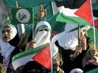 Jordanian supporters of the Muslim Brotherhood wave the Palestinian flag as they gather during a protest to celebrate the 'Gaza victory' in the war against Israel, in the capital Amman on August 8, 2014.