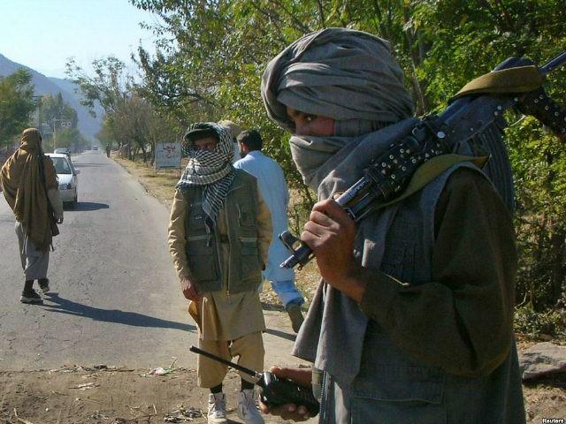 Masked Pakistani pro- Taliban militants who are supporters of Maulana Fazlullah in Pakistan's Swat valley November 2, 2007. REUTERS/SHERIN ZADA KANJU/FILES