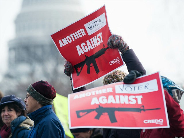 WASHINGTON, D.C. - JANUARY 26: Gun control supporters march from the U.S. Capitol to the Washington Monument to call on Congress to pass gun control measures on January. 26, 2013 in Washington, D.C. (Photo by Bill Clark/Getty Images)