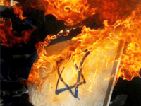 GAZA CITY, GAZA STRIP - APRIL 17: The Israeli flag is burned by Palestinian militants during an anti-Israel rally on April 17, 2004, in Gaza, Gaza Strip. Thousands of palestinians attended demonstrations, to support prisoners who are held in israeli jails in towns and refugee camps along the Gaza Strip, during the Palestinian Prisoner Day. (Photo by Abid Katib/Getty Images)