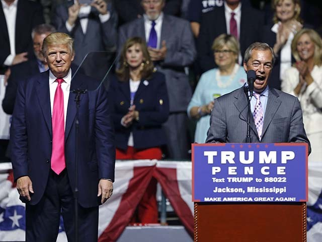 Nigel Farage, ex-leader of the British UKIP party, speaks as Republican presidential candidate Donald Trump, left, listens, at Trump's campaign rally in Jackson, Miss., Wednesday, Aug. 24, 2016. (AP Photo/Gerald Herbert)