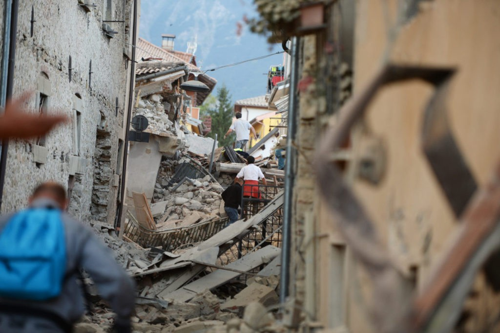 Residents search for victims among damaged buildings after a strong heartquake hit Amatrice on August 24, 2016. Central Italy was struck by a powerful, 6.2-magnitude earthquake in the early hours, which has killed at least three people and devastated dozens of mountain villages. Numerous buildings had collapsed in communities close to the epicenter of the quake near the town of Norcia in the region of Umbria, witnesses told Italian media, with an increase in the death toll highly likely. / AFP / FILIPPO MONTEFORTE (Photo credit should read FILIPPO MONTEFORTE/AFP/Getty Images)
