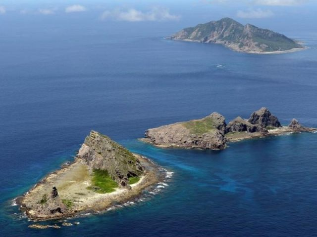 File photo taken in September 2012 shows (from front) Minamikojima, Kitakojima and Uotsuri islands of the Senkaku Islands in the East China Sea. The Chinese army is weighing the full use of unmanned aircraft to regularly monitor the East China Sea, a move that may add fuel to heightened tension in the area where Japanese-controlled islands claimed by China lie, a Chinese document on the country's use of drones showed June 12, 2015. (Kyodo via AP Images)