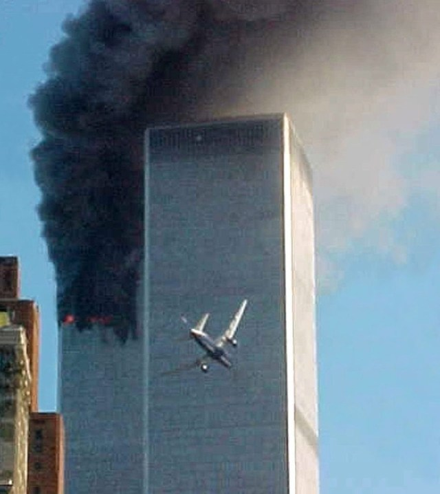 ** ADVANCE FOR TUESDAY, NOV. 4, 2008 AND THEREAFTER ** FILE ** In this Sept. 11, 2001 file photo, a jet airliner nears one of the World Trade Center towers in New York. For all of the candidates' talk about the need for change, Americans have seen plenty of it since the last time they selected a new leader - including the attack on the World trade Center in 2001. (AP Photo/Carmen Taylor/File)