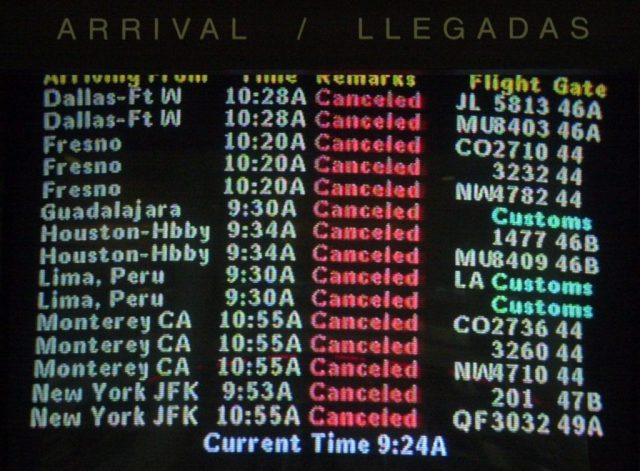 A sreen at the American Airlines terminal at Los Angeles Internatinal Airport shows that all flights have been canceled as the airport is shutdown, Tuesday, Sept. 11, 2001. In one of the most horrifying attacks ever against the United States, terrorists crashed two airliners into the World Trade Center in a deadly series of blows that brought down the twin 110-story towers. A plane also slammed into the Pentagon as the government itself came under attack. (AP Photo/Nick Ut)