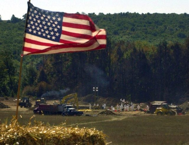 A makeshift altar, constructed for a worship service, overlooks the the crash site of United Airlines Flight 93, Sunday, Sept. 16, 2001, in Shanksville, Pa. The plane was hijacked and crashed during Tuesday's terrorist attacks. (AP Photo/Gene J. Puskar)
