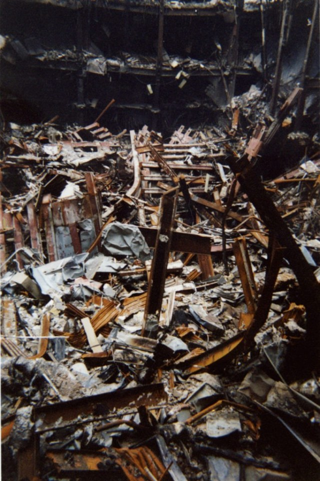 """This undated photo of two metal beams, center, that form a cross that rises out of the destruction at the World Trade Center, was made available in New York, Thursday, Oct. 4, 2001. The cast iron """"cross,"""" which fell intact from Tower One into nearby Building Six on Sept. 11., was blessed on Thursday by Rev. Brian Jordan, a Franciscan priest, as rescue workers who have adopted it as a symbol of faith gathered around to watch. (AP Photo/Pool)"""