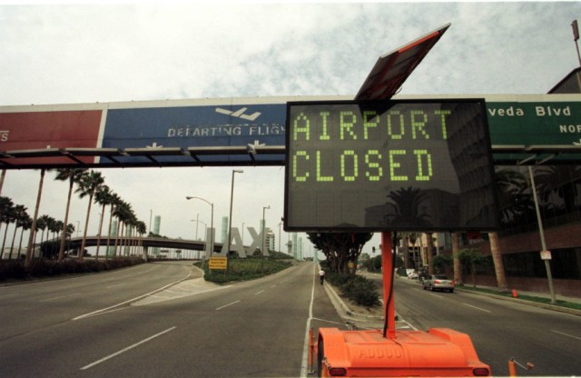 A board at the Los Angeles Airport announces the closing of the airport following an alleged coordinated terrorist attack to the World Trade Center twin towers in New York and the Pentagon in Washington DC 11 September, 2001. Some of the hijacked planes used for the attacks were heading to Los Angeles. AFP PHOTO Gerard Buckhart (Photo credit should read GERARD BURKHART/AFP/Getty Images)