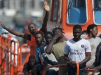 A group of immigrants wave as they arrive on a Spanish coast guard vessel into the southern Spanish port of Malaga on August 31, 2016 after an inflatable boat carrying 52 Africans, nine of them women, was rescued by the Spanish coast guard off the Spanish coast. / AFP / JORGE GUERRERO (Photo credit should read JORGE GUERRERO/AFP/Getty Images)