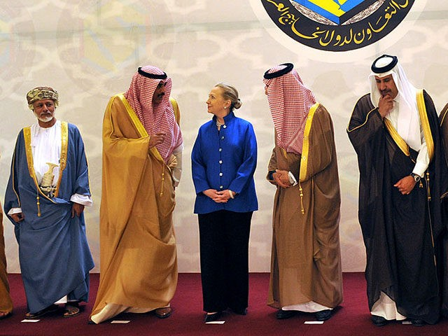 From left to right: United Arab Emirates' Foreign Minister Abdallah bin Zayed al-Nahyan, Omani Minister of Foreign Affairs Yussef bin Alawi bin Abdullah, Kuwaiti Foreign Minister Sheikh Sabah Khaled al-Hamad Al-Sabah, US Secretary of State Hillary Rodham Clinton, Saudi Foreign Minister Prince Saud Al-Faisal, Qatar's Prime Minister and Foreign Minister Sheikh Hamad Bin Jassim Bin Jabr Al-Thani, Bahrain's Foreign Minister Khalid bin Ahmed al-Khalifa, pose for a group photo before a US- Gulf Cooperation Council forum at the Gulf Cooperation Council Secretariat on March 31, 2012 in Riyadh. Secretary Clinton promoted a missile shield to protect Gulf Arab states from Tehran and sought to work with them to help end the violence in Iran's ally Syria during her visit to Saudi Arabia. AFP PHOTO/FAYEZ NURELDINE (Photo credit should read FAYEZ NURELDINE/AFP/Getty Images)
