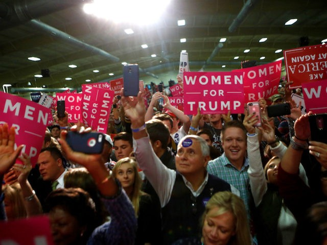 FLETCHER, NC - OCTOBER 21: Supporters of Republican presidential candidate Donald Trump cheer as he takes to the stage at a rally on October 21, 2016 at the Western North Carolina Agricultural Center in Fletcher, North Carolina. Trump continues to campaign for his run for president of the United States. (Photo by Brian Blanco/Getty Images)
